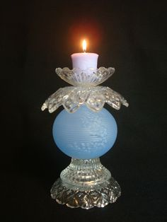 Love this candle stand from old glass pieces