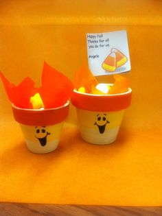 Clay Pot candy cup painted to look like Candy Corn.