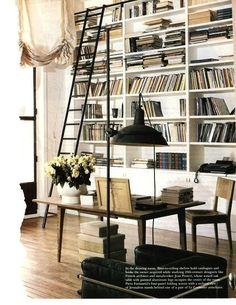 Floor to ceiling bookshelves and ladder - everything within reach! And with that lovely monochrome aesthetic.