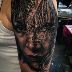 Tony Mancia black and grey upper arm morph tattoo with woman's face and cathedral tracery