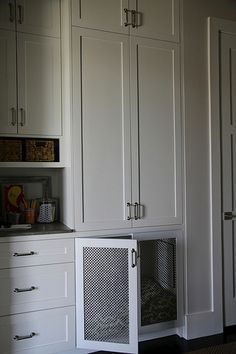 dog bed built in to mudroom cabinetry
