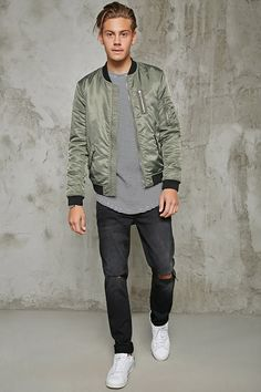 A midweight bomber jacket featuring a zip-up front, ribbed trim, slanted front pockets with snap-button closure, long sleeves, a zippered chest slip pocket, and a zippered utility pocket on the arm.