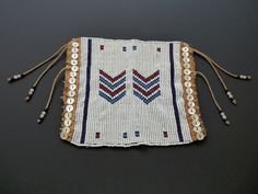 Mfengu man's anklet, usually worn in pairs. Beadwork panel attached to a goatskin backing and tied with hooks and eyes. Beadwork, Beading, Xhosa, Zulu, Bead Weaving, African Art, Anklet, South Africa, Hooks