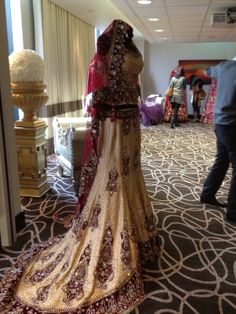 indian wedding dress with a train, red and whit bridal lehenga