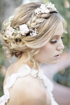 bridal updo with braid and flowers