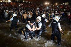 Brasilia National Congress - cops cornered in water mirror#ChangeBrazil #oGiganteAcordou #OccupyBrasil