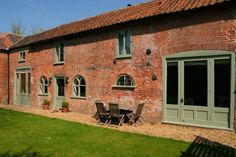 Lovely red brick barn conversion - variety of windows, paint color brings interest/statement to the windows Barn Windows, Windows And Doors, Front Doors, Barn Conversion Exterior, Barn Conversions, Brick Cottage, Contemporary Barn, Converted Barn, External Doors