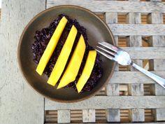 Black coconut rice and mango porridge - a healthy warm breakfast alternative.