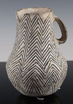 Rare Anasazi Gallup black and white pitcher with an unusual flattened handle great fine line zig zag painted motif. No restoration, as found. 6.5 inches tall, guaranteed authentic 1030 AD - 1125 AD