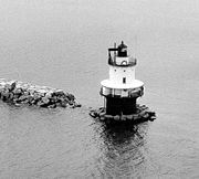 Crabtree Ledge Light was a sparkplug lighthouse on Frenchman Bay, Maine. It was first established in 1890 and deactivated in 1933. It was a brown conical tower on a black cylindrical pier located on Crabtree Ledge, about 1/4 mile off of Crabtree Neck at the north end of Frenchman Bay.