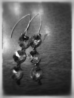 $45 Forty eight years ago a newly wed couple left the winds of Chicago and bought a hotel in Boyne City, Michigan. When they were cleaning out the attic they found a box of chandelier crystals. These crystals are those very crystals - connected by delicate vintage rose - they are presented on Sterling Silver ear wires. only one pair. (oh - the couple- my parents - still married)