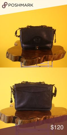 DOONEY AND BOURKE BLACK LEATHER CROSSBODY VINTAGE DOONEY AND BOURKE 100% ALL WEATHER LEATHER GENUINE MESSENGER BAG. MEDIUM SIZE WITH MINIMAL NATURAL LEATHER WEAR. LIKE NEW MINT CONDITION. Dooney & Bourke Bags Crossbody Bags