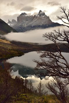 Katsu Tanaka photo of trees, mountains and a lake with reflections of the mountains and trees in the water, shot in Patagonia