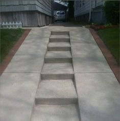 Stairs built into a steep driveway. Would need sweeping though... but could line them with some lights for visitors