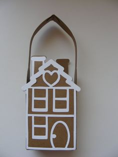 Does anyone out there know where to find a pattern for this?  I've checked Cricut & Silhouette and can't find anything.  Ginger Bread House Gift bag made from Kraft Cardstock.