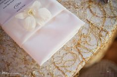 Gold sequin table linens and an orchid bloom at each placesetting. Real Wedding - Great Harbor Yacht Club, Nantucket. Read more about Jessica & Steve's Nantucket Wedding on the blog! www.blog.soireefloral.com #soiree #floral #nantucket #wedding #brea #mcdonald