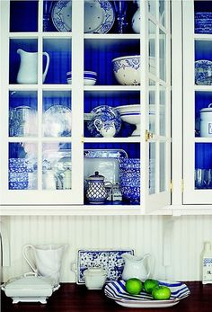 A perfect blue on the interior of this white cabinet enhances the blue & white wares.