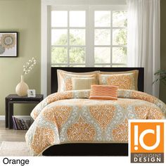 The Sabrina comforter set will surely make a fashion statement in your bedroom. Choose from the vibrant orange and taupe, or large black and gray damask print, which will add a pop of color to this comforter.