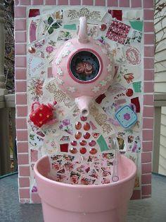 Pink teapot fountain mosaic