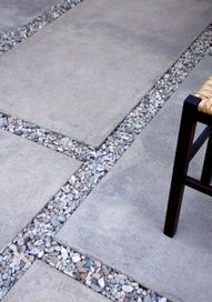 Coordinate your gravel pieces to fit with your color outdoor decor. Breaks up the grid of the floor nicely!