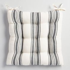 Comfy and classic, our cotton cushion features black French-style stripes set against a natural background. Pair it with our coordinating table linens for an effortlessly put-together look.