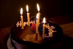 chocolate glaze and five yellow candles.