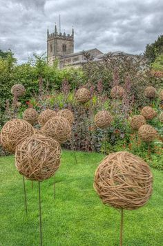 Scuptures in the garden near the church at Coughton Court, Alcester, England