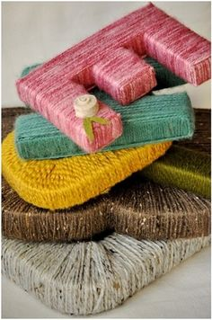 Yarn Letters. Go to hobby lobby, grab a letter, yarn, and glue! Great idea