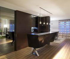 Modern black home wet bar with pendant lighting