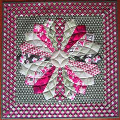Modern Dresden quilt by Quiltscapes.  The quilting makes it look like a Dahlia.