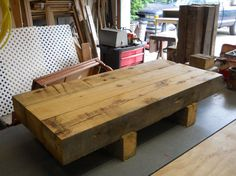"""Barn Beam Coffee Table made with 100 year old barn Beams. The dimensions are 62"""" long by 24"""" wide by 16"""" tall. 