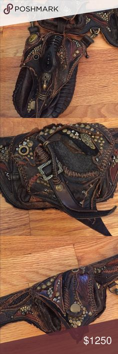 UNIK Handmade Fanny Pack Belt Belly Bag RARE Bought in Bali. Handmade by world famous designer, Unik. One of a kind. Leather and various materials. Brass studding and buckle. Brown, black, brass. The ultimate fanny pack. 4 zippered compartments. Snake head detail. Looks like it belongs in the movie Mad Max. Hand, machine stitched. Master leather work. Extremely unique & rare, true one of a kind. Detachable hip bag w/brass clamps. Festivals, Burning Man, Lollapalooza. Great for day to day…