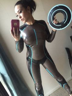 Semi-transparent smoke colored latex tron catsuit with with black and blue trim.  If this is what the future looks like - count us in!. DIY the look yourself: http://mjtrends.com/pins.php?name=latex-for-tron-cosplay-catsuit