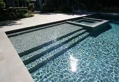Image result for luxury pool with sun shelf…