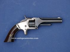Image from http://www.antiquearmsinc.com/images/smith-and-wesson-first-model-1st-2nd-issue-tip-up-action-revolver-civil-war-1861-antique-guns/smith-and-wesson-first-model-1st-2nd-issue-tip-up-action-revolver-civil-war-1861-antique-guns-2.jpg.
