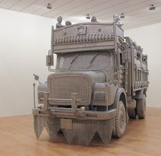 An Ornate Truck Spot-Welded from lots and lots of Reflective metal Disks by Valay Shende - Cretíque