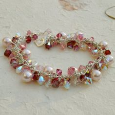 Pink Pearl Bracelet Swarovski Ruby and Rose Crystal ... This would be pretty in black and white.