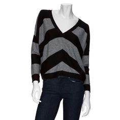 Splendid Gray V-neck Sweater Super cute Splendid Size medium grey and black sweater! Graphic Chevron Sripes make a bold statement on this Splendid V-neck sweater. V neck, long dolman banded hem. Nylon/viscose/wool. Perfect with boots and jeans or even for work! Only worn twice-perfect condition! Splendid Sweaters V-Necks