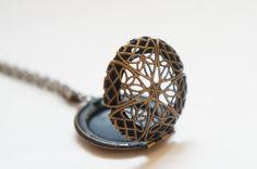 Star - Antiqued Brass Romantic Round Star Pattern Locket Necklace. $9.99, via Etsy.