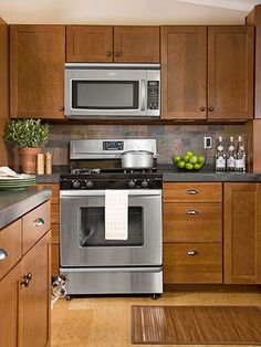 Luxury Slate Appliances with Maple Cabinets