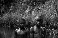 reinopin: photo by Ryan Lobo : Child soldiers in Liberia :  Kids take a close look at strange film crew.