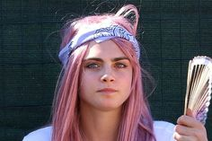 Cara Delevingne has dyed her hair pink, everybody!