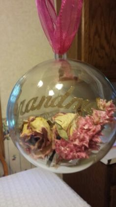 Flowers and ribbon from my grandmothers funeral. Made into Christmas ornament! (xmas gifts for dad children) Memorial Ornaments, Memorial Gifts, Memorial Ideas, Xmas Gifts For Dad, Grandma Gifts, Clear Ornaments, Flower Ornaments, Christmas Bulbs, Christmas Crafts