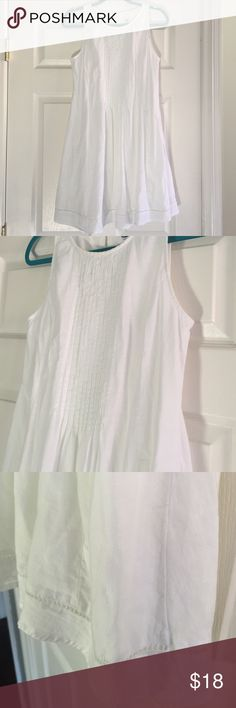 Pretty white dress Old Navy white cotton dress, size small.  Sleeveless, gathered pleats in front, zip side, keyhole with bottom back, open embroidered border near hem.  Defined waist with fuller skirt.  Lined.  So pretty!  NWOT Old Navy Dresses Midi