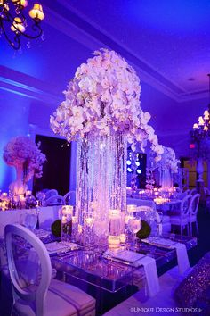Cascading crystal and orchid centerpiece from Melissa and Dean's reception. Wedding and design by Tiffany Cook Events
