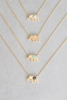 Stone studded elephant charm necklace. Jade stone