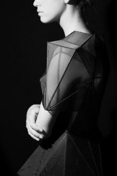 Architectural fashion- glass pane-inspired statement shoulders.