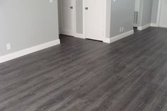 Tokyo Oak Grey Laminate (All rooms, minus the bathroom[s]).