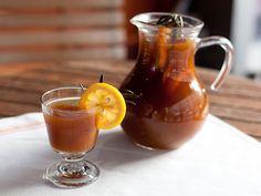 Bolliwood Punch from Slightly Oliver: jamaican rum, brandy, orange juice, lime juice, simple syrup, fresh rosemary, Angostura bitters, ground cardamom, lemon, orange, lime slices