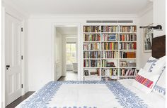 Custom built-in shelves and Coyuchi bedding in Brooklyn renovation by Elizabeth Roberts.